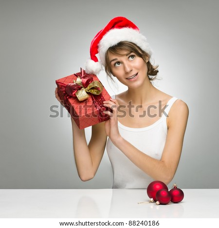 Beautiful santa girl with gift boxes isolated on white - stock photo