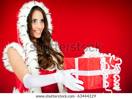 beautiful santa woman with present � side view - stock photo