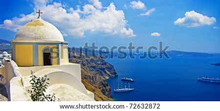 beautiful Santorini - caldera view with small church - stock photo