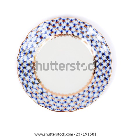 beautiful saucer with the ornament closeup - stock photo