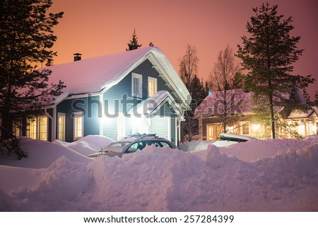 Beautiful scandinavian Finnish swedish norwegian wooden cottage cabin near slopes on a ski resort in the night time