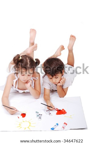 Beautiful scene of a girl and boy laying and playing with colors on ground