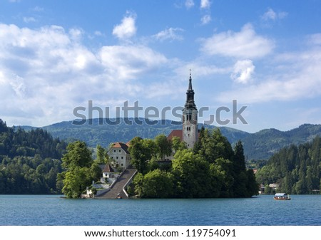 Beautiful scene of Bled Lake in Slovenia, Santa Maria Church is also captured in the picture. - stock photo
