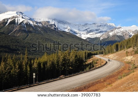 Beautiful scene of morning rocky mountains and highway in kananaskis country, alberta, canada - stock photo