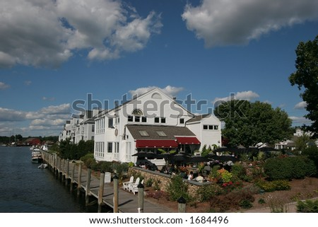 beautiful scene of restaurant along water in Mystic, Connecticut - stock photo