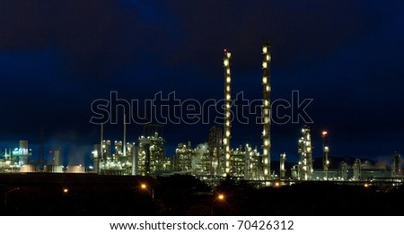Beautiful scenery landscape of the refinery plant in the industrial zone at the night time - stock photo