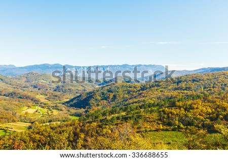 Beautiful scenery of colourful trees on hills in autumn, Slovenia, Europe
