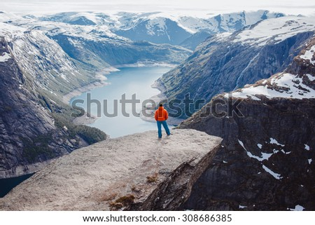 Beautiful scenery of the Norwegian fjords and mountains,active traveller.hiking tour,breathe the fresh air,Freedom concept,rock,mountains,amazed by stunning views.Hiker man,traveling concept - stock photo