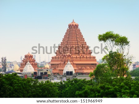 Beautiful scenery - tower of traditional Hindu Temple - Chattapur Mandir against the background of blue sky at evening time in New Delhi - view from subway station, Northern India - stock photo