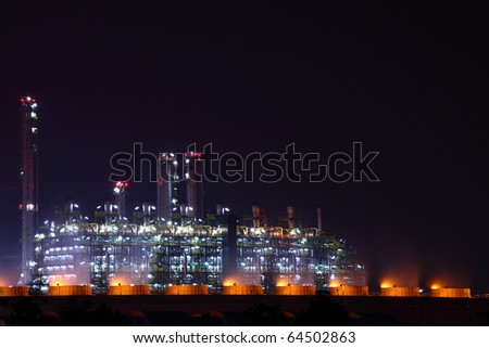 beautiful scenic of petrochemical factory in early night light with shining lights - stock photo