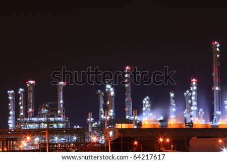 beautiful scenic of petrochemical oil refinery plant shines at night, closeup - stock photo