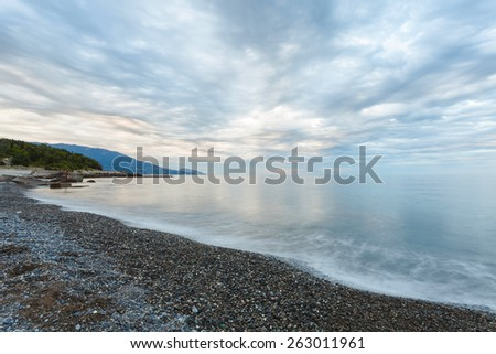 Beautiful scenic sea landscape with dramatic clouds - stock photo
