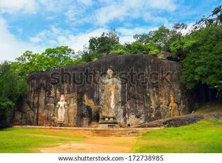 Beautiful scenic view of carved Buddhist Sculpture Rock in Buduruvagala - one of the most mysterious and interesting tourist sightseeing in Sri Lanka, South Asia  - stock photo
