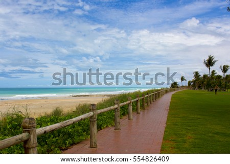 Beautiful  scenic view of famous  Cable Beach, Broome Western Australia,  a 22 kilometre long stretch of white sand, set against red ochre cliffs and fringed by turquoise waters of the Indian Ocean.