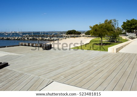 Beautiful scenic view of  new Koombana North landscaped   parkland on the Indian  Ocean in Bunbury Western Australia with the port  in the distance  on a sunny summer morning.