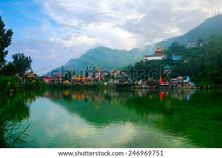 Beautiful scenic view - serene lake Tsopema in Rewalsar (Trisangam) - sacred city for three major Dharma religions - Hinduism, Buddhism and Sikhism, Mandi district, Himachal Pradesh, Northern India - stock photo
