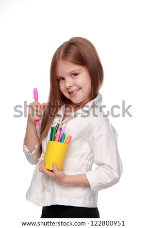 Beautiful schoolgirl smiling happily - stock photo