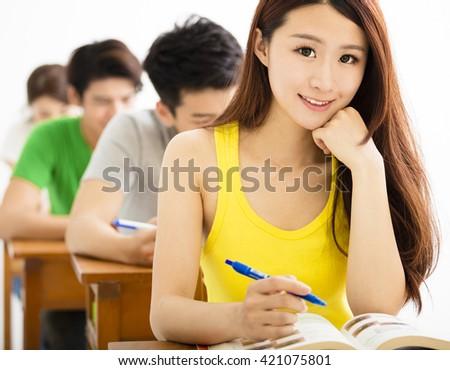 beautiful Schoolgirl Studying In Classroom - stock photo