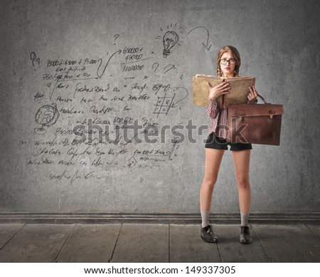beautiful schoolgirl with a big book and folder - stock photo