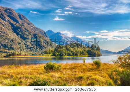 Beautiful Scottish lake - or loch - under harsh Highland mountains, HDR version - stock photo