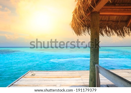Beautiful sea and beach with jetty at Maldives - stock photo