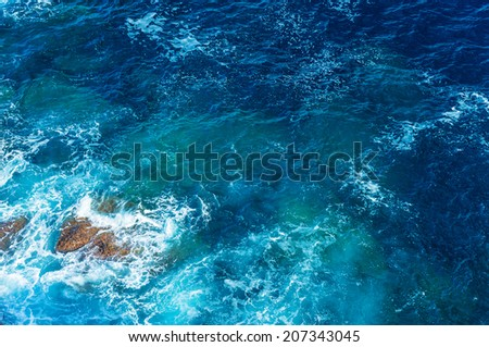 Beautiful sea background, abstract natural backdrop, clean transparent blue water, good summer weather, travel and vacation concept - stock photo