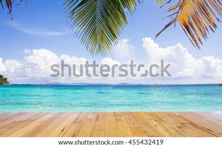 Beautiful sea beach in summer with wooden floor - stock photo