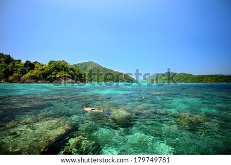Beautiful sea Blue and Green with unknown snoggle man  in Surin Bay at Thailand - stock photo