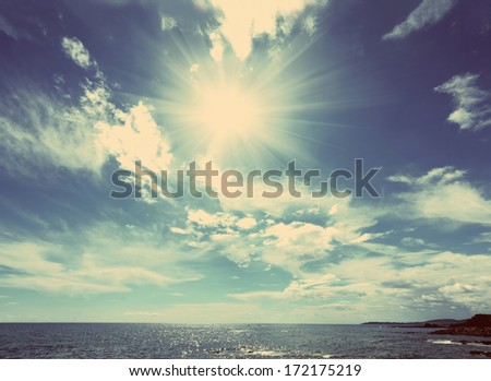 beautiful sea landscape with sun and clouds - vintage retro style - stock photo