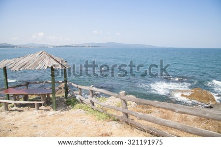 Beautiful sea summer landscape against the blue sky with white clouds  - stock photo