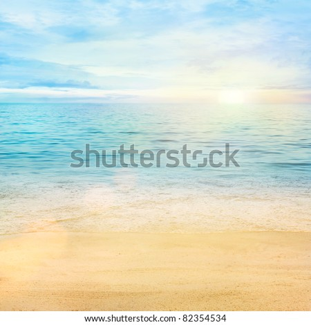Beautiful sea summer or spring abstract background. Golden sand beach with blue ocean and cloudscape and sunset in the back. - stock photo