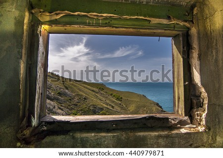 Beautiful  sea view  through the frame of the ugly old window . Crimea. Black Sea.