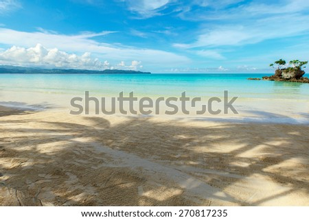 Beautiful sea view with yellow sand beach blue ocean and white clouds in the sky