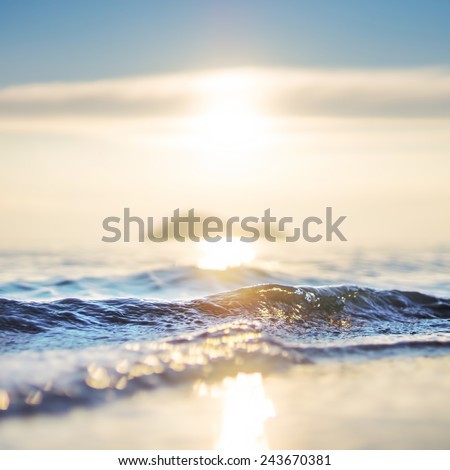 Beautiful sea wave and sky at sunset - stock photo