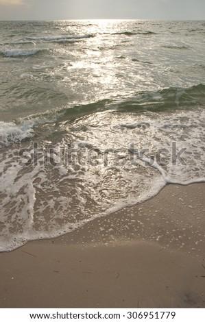 Beautiful Sea Waves on the Beach with Sunset Sunlight. - stock photo