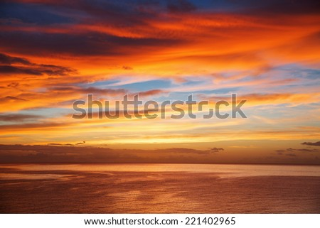 Beautiful seascape at sunrise and clouds in summer - stock photo