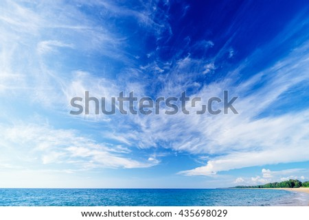 Beautiful seascape. Beach with blue cloudy sky. - stock photo
