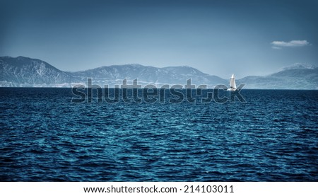 Beautiful seascape, dark blue sea on high mountains background, luxury yacht floating in the distance, summer vacation concept - stock photo