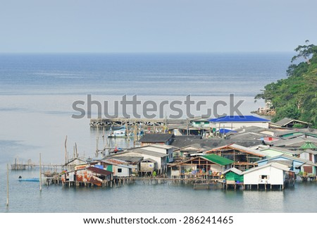 Beautiful seascape in morning time with fisherman village - stock photo