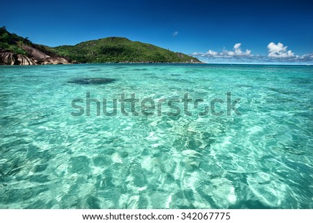 Beautiful seascape of tropical beach and turquoise water / outdoors photography of picturesque Seychelle islands - stock photo