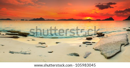 Beautiful seascape panorama. Stone on the foreground. Philippines - stock photo