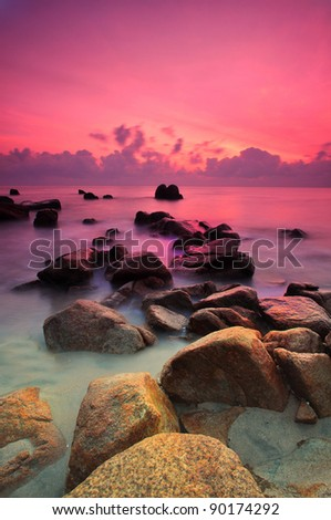 Beautiful seascape. Sea and rock at the sunset. Nature composition. - stock photo
