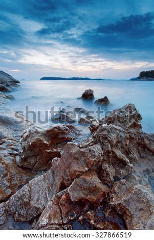Beautiful seascape. Seascape with a slow shutter speed in the setting time.