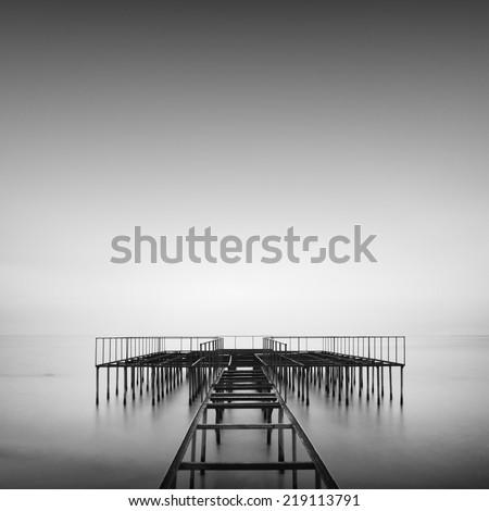 Beautiful seascape shot with old metal pier on the sea. Odessa, Ukraine - stock photo