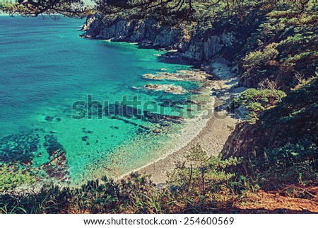 Beautiful seascape, tropical blue lagoon among hills in summer - stock photo