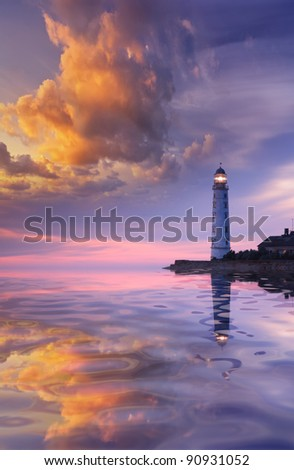 Beautiful seascape with a lighthouse at sunset - stock photo