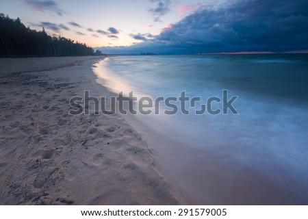 Beautiful seascape with Baltic sea shore after sunset. Gdansk, Gorki Zachodnie area near Vistula river mouth. - stock photo
