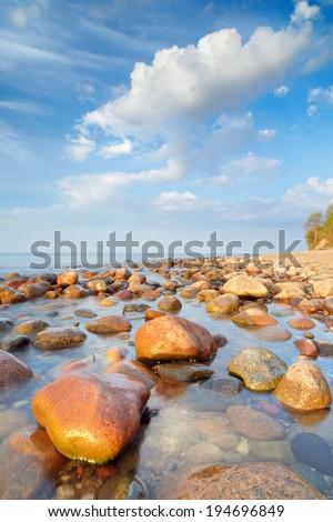 Beautiful seascape with coastal stones in the ocean. The Baltic coast, mediterranean sea, Poland. - stock photo