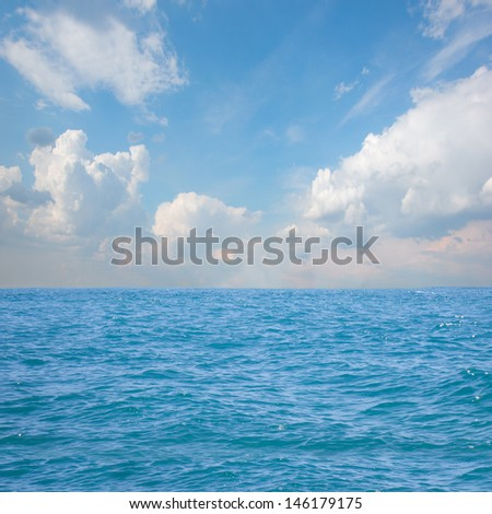 beautiful seascape with deep blue waters and cloudscape - stock photo