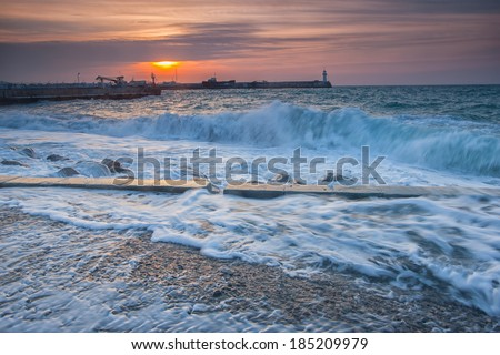 Beautiful seascape with lighthouse on sunrise